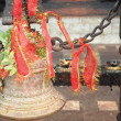 Stock Photo: Bronze bell and red ribbon. Manakamana-Nepal. 0330