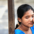 Stock Photo: Thoughtful Nepali young woman-blue dressed. Bandipur-Nepal. 0399