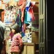 Stock Photo: Nepali young girl in shop with shopkeeper. Bandipu-Nepal. 0401