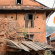 Stock Photo: Old red brick house with rising sun flag. Bandipur-Nepal. 0393