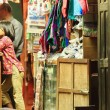 Stock Photo: Newar little girl in shop with shopkeeper. Bandipur-Nepal. 0403