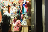 Nepali young girl in shop with shopkeeper. Bandipu-Nepal. 0401 — Stock Photo