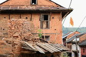 Old red brick house with rising sun flag. Bandipur-Nepal. 0393 — Stock Photo