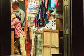 Newar little girl in shop with shopkeeper. Bandipur-Nepal. 0403 — Stock Photo