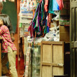 Stock Photo: Nice young girl in local textile shop. Bandipur-Nepal. 0404