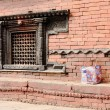 Stock Photo: Carved lattice window and snake frieze. GorkhDurbar-Nepal. 0414