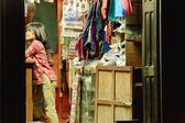 Nice young girl in local textile shop. Bandipur-Nepal. 0404 — Stock Photo