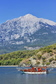 Yacht in a bay on mountains background — Stock Photo