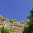 High-voltage power line in mountains — Stockfoto #13714046