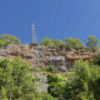 Foto Stock: High-voltage power line in mountains