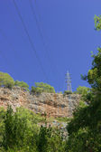 High-voltage power line in mountains — Stock Photo