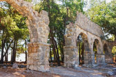 Ruins of ancient aqueduct at Phaselis, Turkey. — Foto de Stock