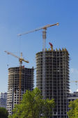 Construction site with cranes and buildings. — Stock Photo