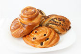 Sweet buns with cinnamon and raisins. — Stock Photo