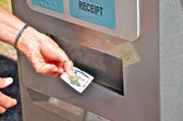 Taking a transit ticket from the dispenser. — Stock Photo