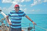Sailor enjoying an afternoon sail — Stock Photo