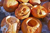 Pumpkins and Jack-o-lanterns at Recycling Depot — Stock Photo