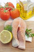 Raw salmon steak closeup in the kitchen — Stock Photo