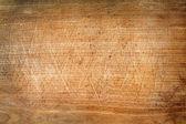 Old grunge wooden cutting kitchen desk board — Stock Photo