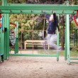 Playground and girl in motion on the ladder go to success — Stock Photo