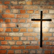 Cross and grunge wall on cemetery abstract background — Stock Photo #12488112