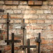 Cross and grunge wall on cemetery abstract background — Stock Photo #12488131