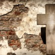 Cross and grunge wall on cemetery abstract background — Stock Photo #12488148