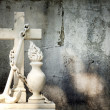 Cross and grunge wall on cemetery abstract background — Stock Photo #12488152