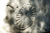Abstract grunge wall on cemetery with shield and sword — Stock Photo