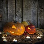 Halloween dýně na starých grunge a svíčky — Stock fotografie
