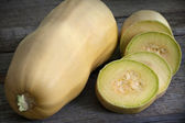 Cucurbit slices on wooden boards — Stock Photo
