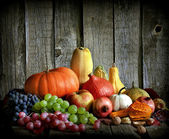 Fruits and vegetables with pumpkins in autumn vintage still life — Stock Photo