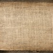 Burlap jute canvas vintage background on wooden boards — Stock Photo
