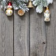 Christmas tree baubles background on vintage wooden boards — Stockfoto