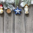 Christmas tree baubles background on vintage wooden boards — Stock Photo #13568343