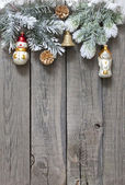 Christmas tree baubles background on vintage wooden boards — Photo