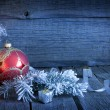 Christmas vintage background with candle and bauble in night — Stock Photo