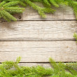 Royalty-Free Stock Photo: Christmas background border with fir on wooden boards
