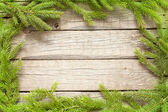 Christmas background border with fir on wooden boards — Stock Photo