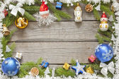 Christmas background border with baubles on wooden boards — Stock Photo