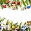 Christmas background border with fir and baubles on white — Stock Photo