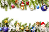 Christmas background border with fir and baubles on white — Stok fotoğraf