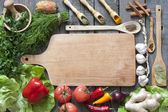 Vegetables and spices vintage border and empty cutting board — Stock Photo
