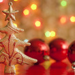 Christmas tree and baubles against blurred colorful background — Stock Photo #13997087