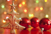 Christmas tree and baubles against blurred colorful background — Stock Photo