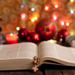 Christmas and bible with blurred candles light background — ストック写真