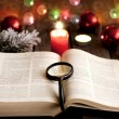 Stockfoto: Christmas and bible with blurred candles light background