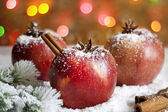 Christmas food apples on snow closeup and blurred background — Stock Photo