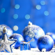 Christmas star closeup and baubles on blue blurred background — Stock Photo #14181520