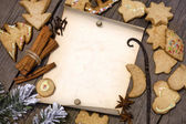 Christmas cookies and old vintage blank paper on wooden boards — Stock Photo